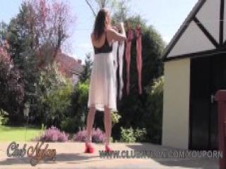 Sexy Milf Nylon Jane teases her stockings legs feet and ass on laundry day in the garden